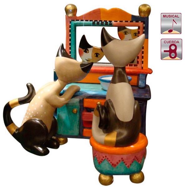 gatos en el espejo